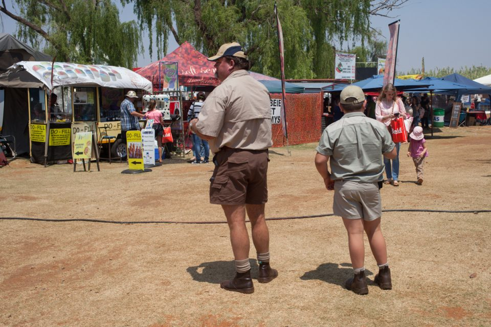 "Father and son wearing similar clothes at market, Potchefstroom. Photograph by Sipho Mpongo from the ""Twenty Journey Project"" - www.twentyjourney.com"